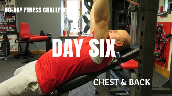 Man doing a chest press with a bar