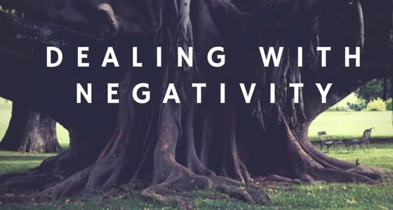 dealing with negativity text written on a tree